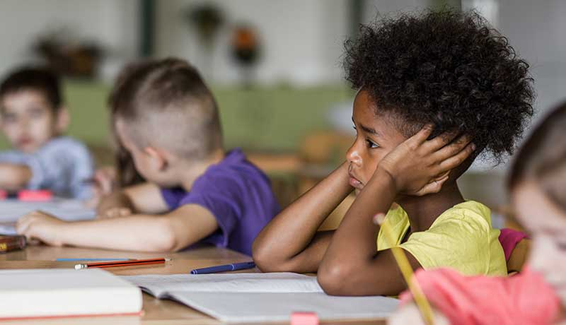 Students sit in class bored and disengaged during weak core instruction.