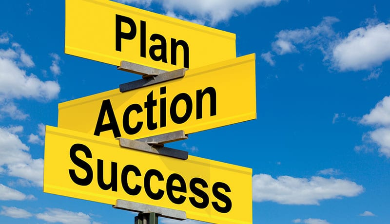 Yellow road signs pointing in different directions with the words plan, action, and success on the signs